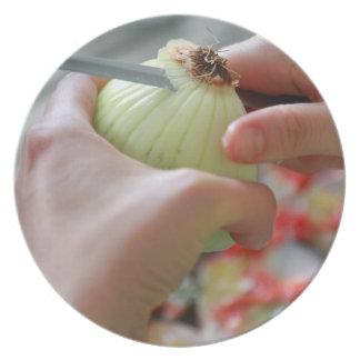 Cortar una cebolla plato
