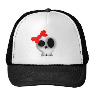 Cráneo bonito con el arco rojo gorro