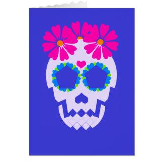 Cráneo con la tarjeta de felicitación de las