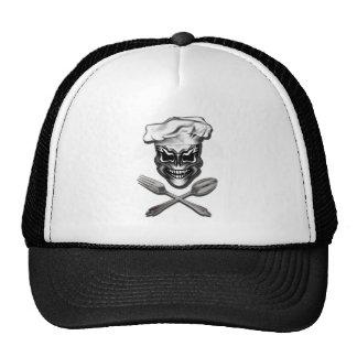 Cráneo del cocinero con la bifurcación y la cuchar gorras