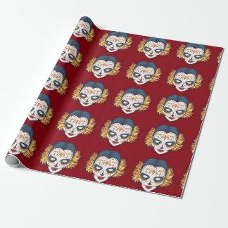 Cráneo femenino del azúcar en de color rojo oscuro papel de regalo