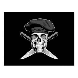 Cráneo y cuchillos del cocinero postal