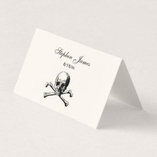 Cráneo y marfil de la tarjeta del acompañamiento