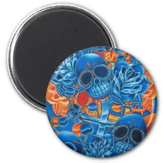 Cráneos azules y anaranjados imán de frigorífico