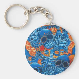 Cráneos azules y anaranjados llavero redondo tipo chapa