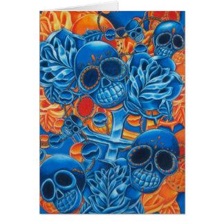 Cráneos azules y anaranjados tarjeta