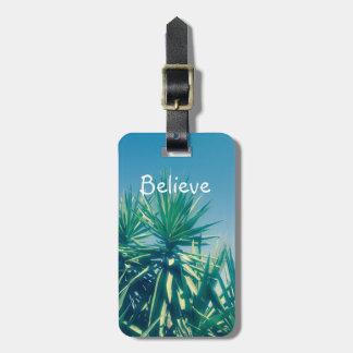 Crea la fotografía de motivación de las palmeras etiqueta para maletas