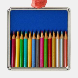 Creyones coloridos del lápiz en fondo azul ornamentos de reyes magos