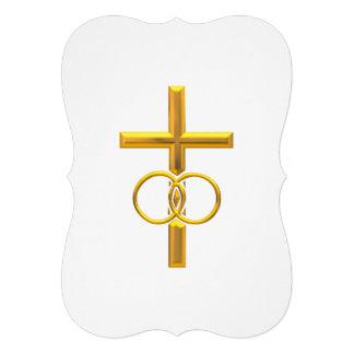 Cruz tridimensional de oro con los anillos de boda