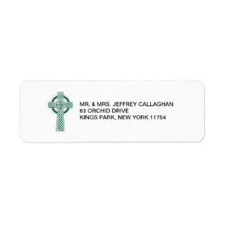 Cruz verde oscuro con el remite etiquetas de remite