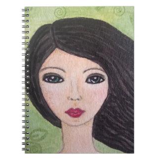 Cuaderno azotado por el viento del chica