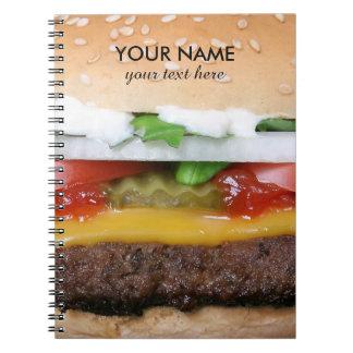 Cuaderno cheeseburger delicioso con la fotografía de las