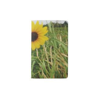 Cuaderno de bolsillo amarillo del girasol