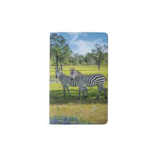 Cuaderno de Moleskine del bolsillo de las cebras y