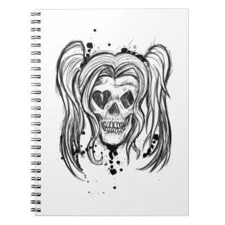 Cuaderno del cráneo del chica