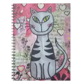 Cuaderno feliz del gatito