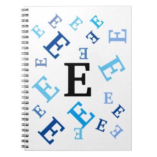Cuaderno - letras azules embarulladas