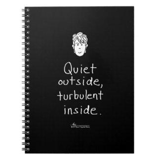 Cuaderno negro interior turbulento