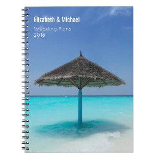 Cuaderno Paraguas cubierto con paja en planes tropicales