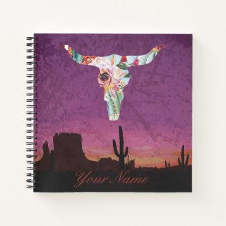 Cuaderno Puesta del sol púrpura del desierto con el cráneo