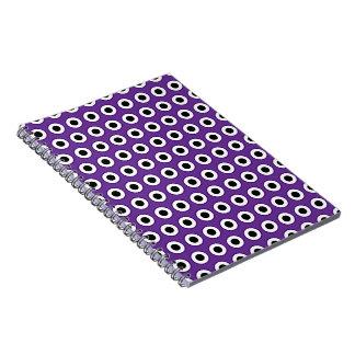 Cuaderno púrpura y negro del punto