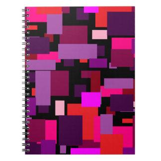 Cuaderno púrpura y rosado de la teja