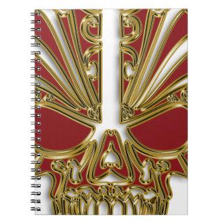 Cuaderno Rojo y cráneo del cráneo del azúcar del oro
