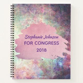 Cuaderno Rosa y textura multicolora púrpura del Grunge