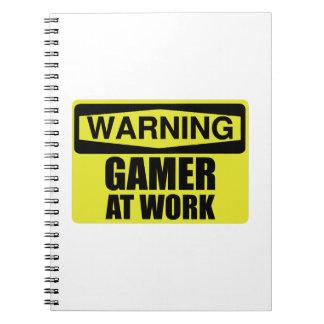 Cuaderno Videojugador de la señal de peligro en el trabajo