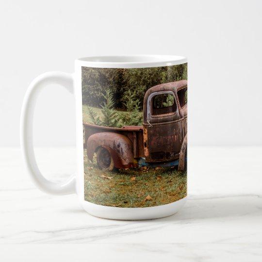 Cuatro camiones viejos taza de café