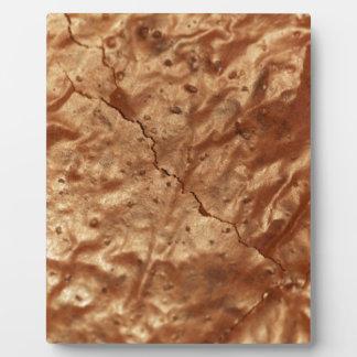Cubierta del chocolate de una torta placa expositora