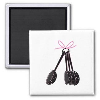 Cucharas dosificadoras negras con rosa imán