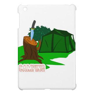 Cuchillo y tienda que acampan