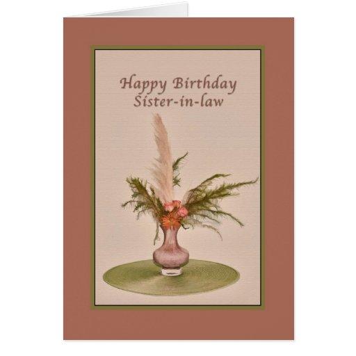 Cumpleaños, cuñada, florero de rosas y helechos felicitación