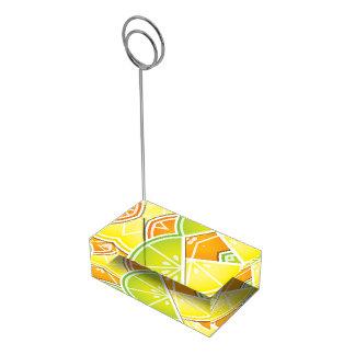 Cuñas enrrolladas de la fruta cítrica soporte para tarjeta de mesa