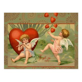 Cupids del vintage el día de San Valentín con los Postal