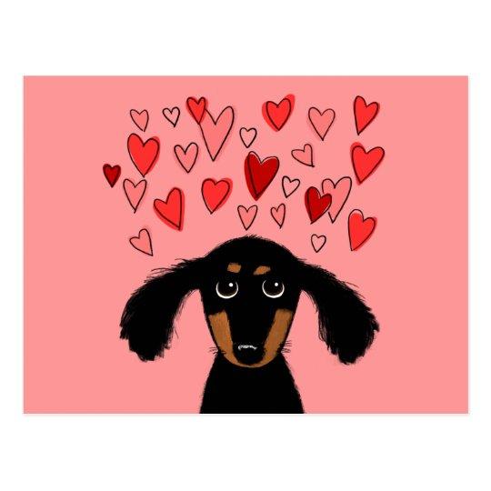 Dachshund lindo con los corazones de la tarjeta