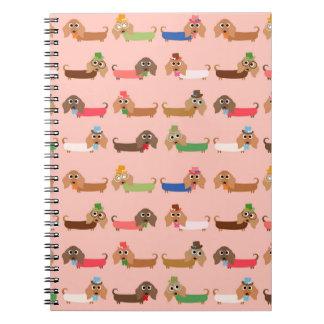 Dachshunds en rosa cuaderno