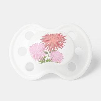 Dalias de las flores en un florero chupete