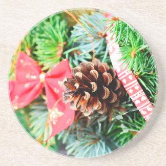 Decoración de la guirnalda del navidad apoyavasos