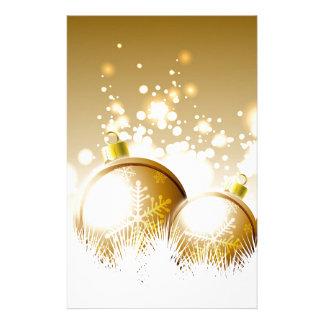 Decoración marrón de oro del Año Nuevo con nieve Papelería