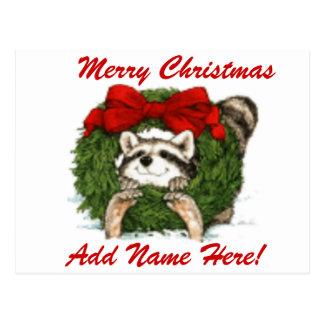 Decoración y mapache de la guirnalda del navidad postal