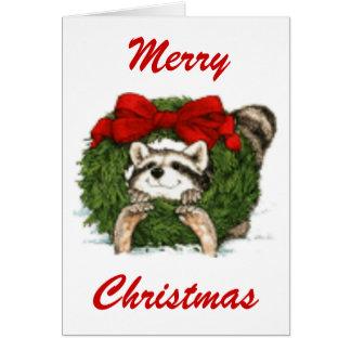 Decoración y mapache de la guirnalda del navidad tarjeta de felicitación