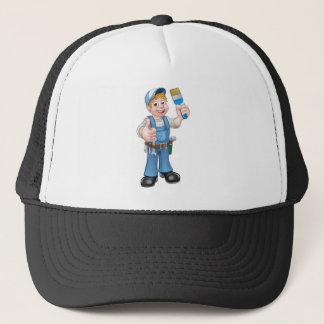 Decorador del pintor de la manitas que sostiene la gorra de camionero