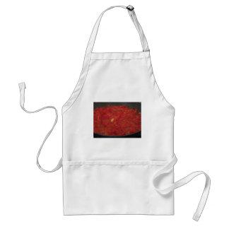 Delantal Cocinar la salsa de tomate hecha en casa usando