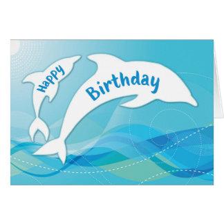 Delfín que salta en feliz cumpleaños del océano tarjeta de felicitación