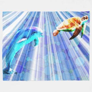 Delfín y tortuga de mar manta polar