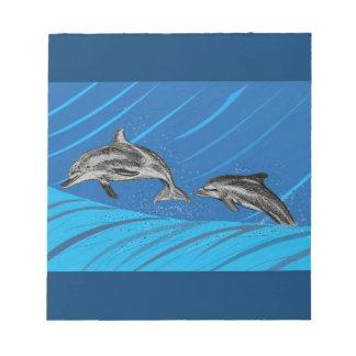 Delfínes en el mar bloc de notas