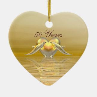 Delfínes y corazón de oro del aniversario