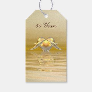 Delfínes y corazón de oro del aniversario etiquetas para regalos
